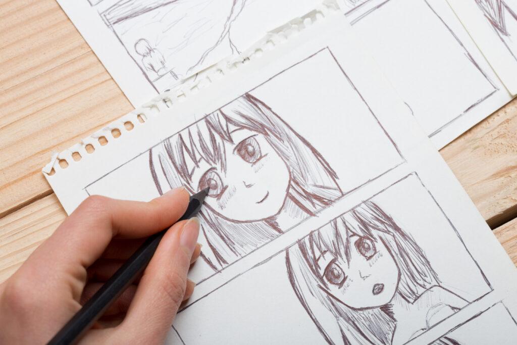 Artist hand drawing Japanese animé in notebook