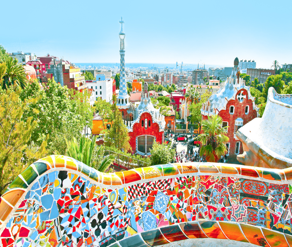Summer Park Guell over bright blue sky in Barcelona, Spain