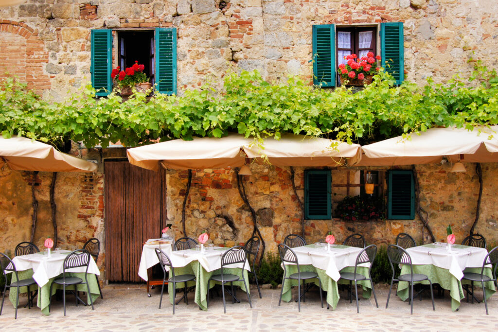 Restaurant front with flowers Italy