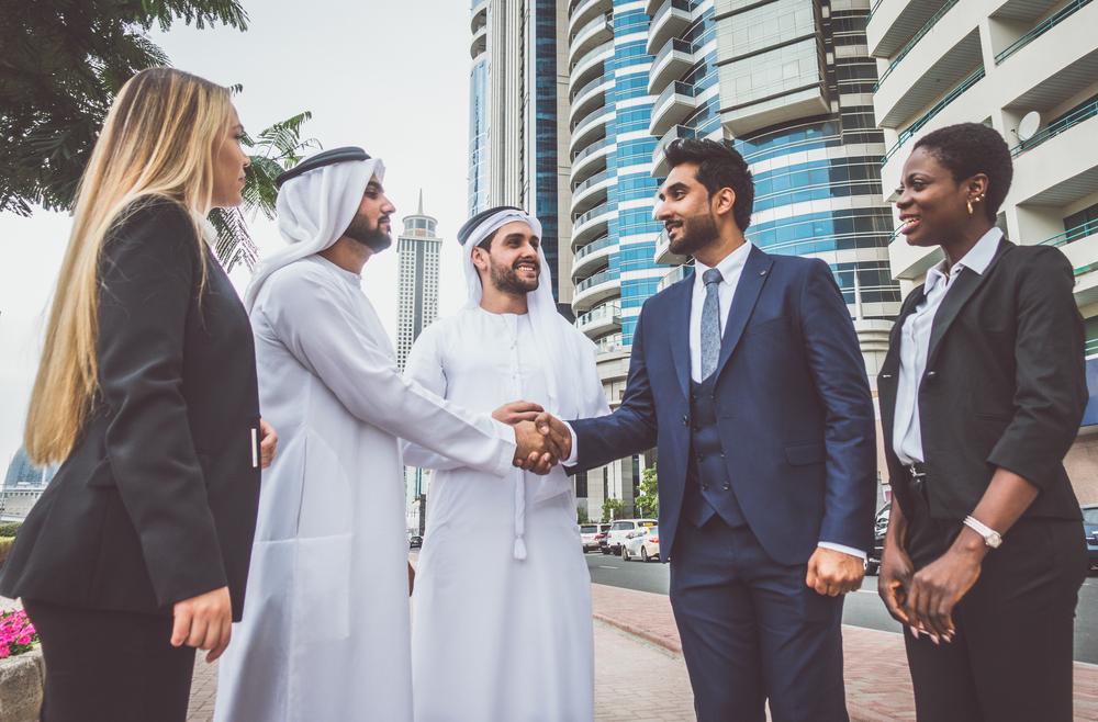 Arab business men shake hands