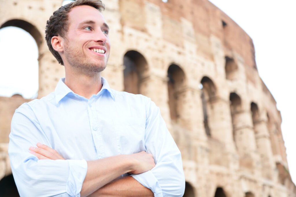 Young business man in front of Colloseum Italy