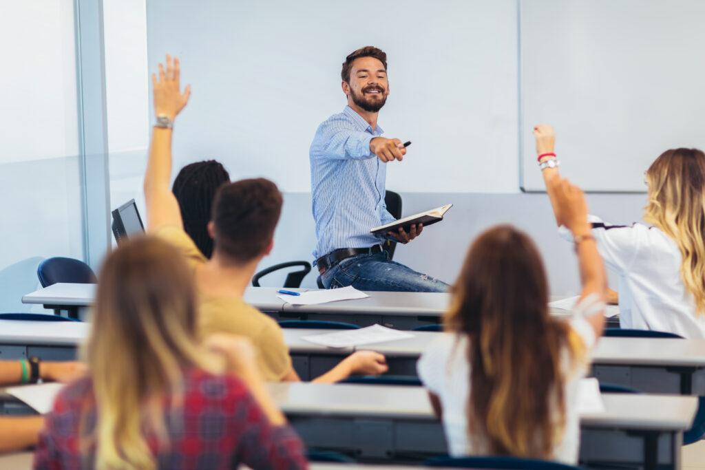 Language Teacher at the top of class