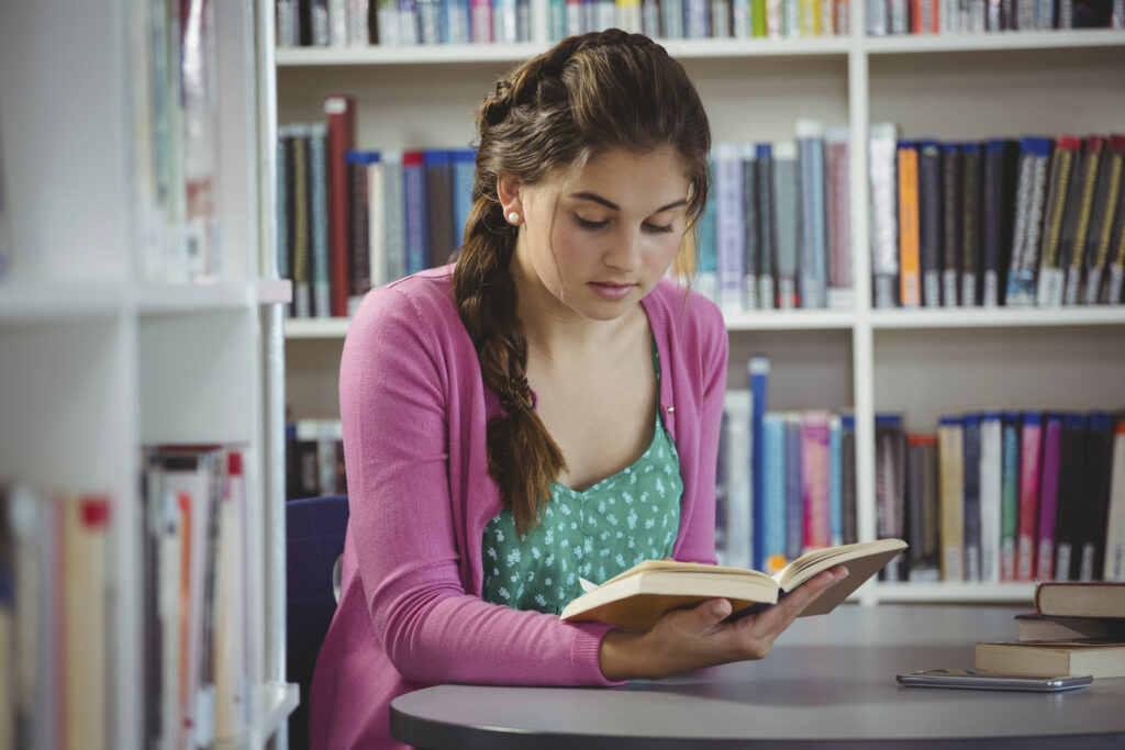 young girl in library